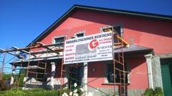 colocación de mampostería de granito en fachada vivienda