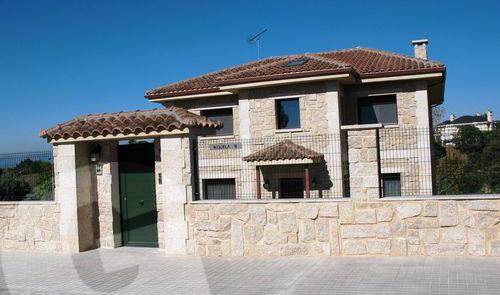 Obras realizadas taco santiago colocacion piedra fachadas granyder - Aplacado piedra fachada ...