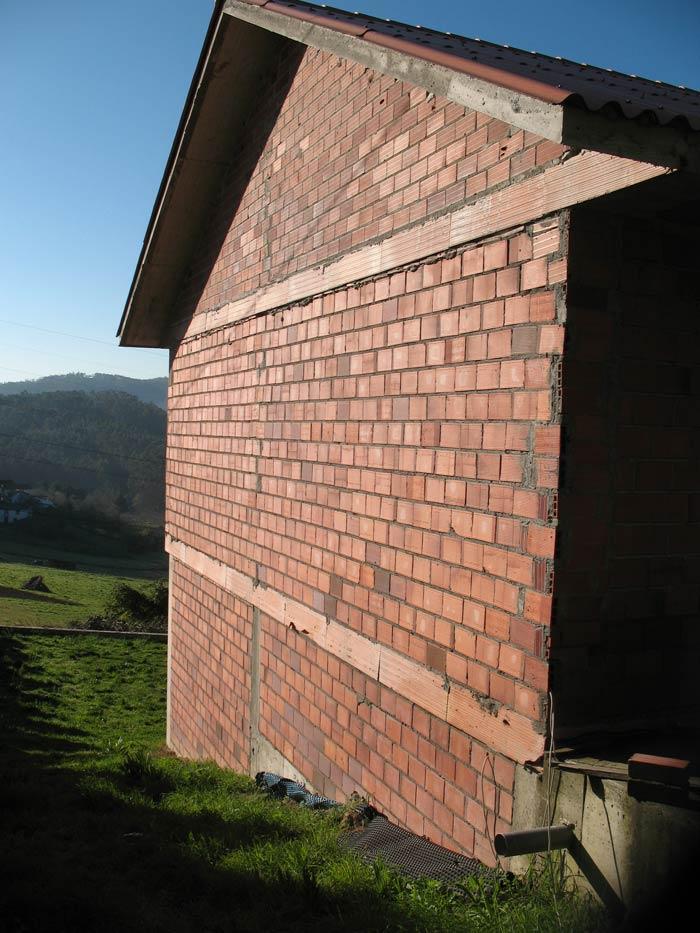 previo colocación piedra en la fachada