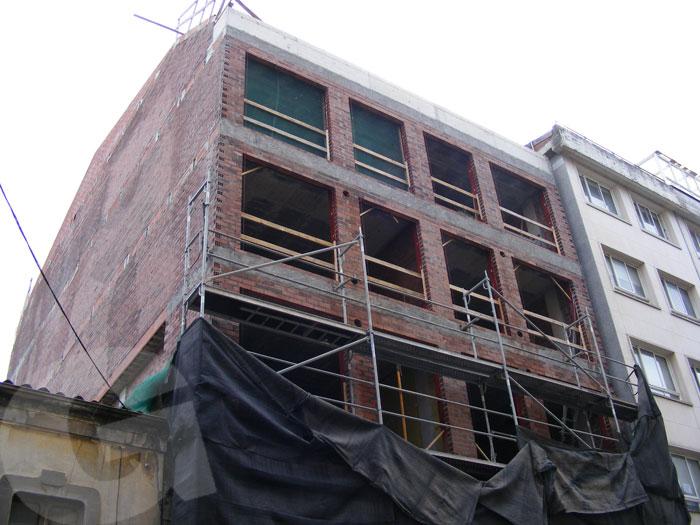 fachada en ladrillo previa a la obra